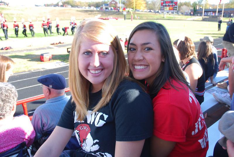 Jordan Love and Annalisa Musarra enjoy watching the marching band perform at the football game.
