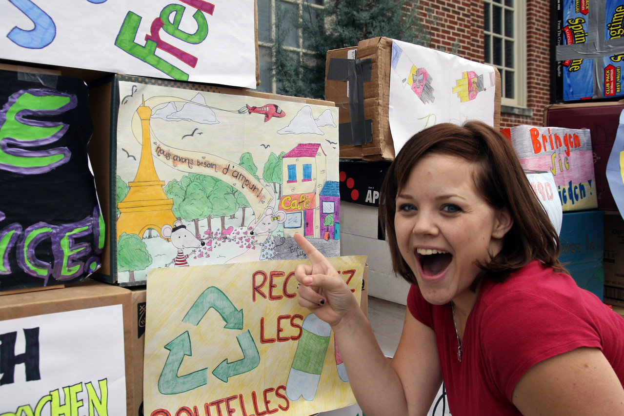 """Tanika Lee shows off her French piece of the """"Berlin Wall"""" she created as part of the commemoration of the fall of the Wall Monday afternoon."""