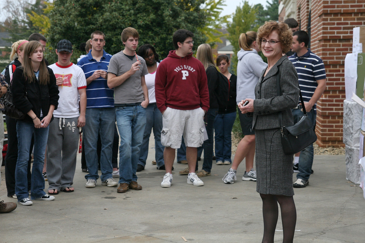 Dr. Ute Lahaie, professor of German, discusses the history of the Berlin Wall just before students attack it to tear it down.