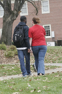 Laura Garand and Latiff Robins walk to the science building to meet with next semester professors.
