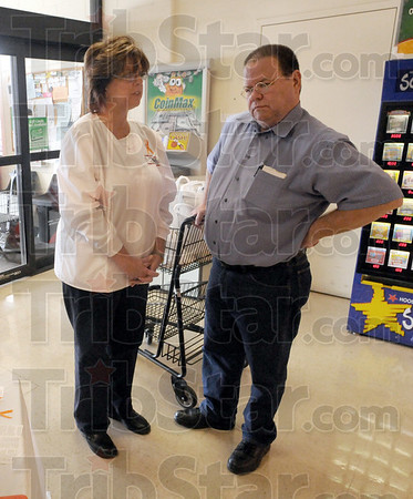 Orange Friday: Robin Heng talks with Baesler's customer Bob Van Sickel as he leaves the store Friday afternoon. She's collecting money for the Orange Friday project. Van Sickel made a donation to the cause.