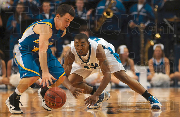 Tribune-Star/Joseph C. Garza<br /> So close to a steal: Indiana State's Harry Marshall eyes the ball as Nebraska-Kearney's Jeremy Cruise tries to maintain control of it during the Sycamores' win Friday at Hulman Center.