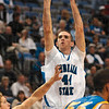 Tribune-Star/Joseph C. Garza<br /> Top scorer: Indiana State's Jake Kelly shoots over Nebraska-Kearney's Jesse Hill for two of his team-high 16 points Friday at Hulman Center.