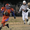 Looking: Linton's #3, Evan Magni looks for an excape route as Fountain Central's #5, Michael Duane closes for the tackle during Friday's regional championship game.