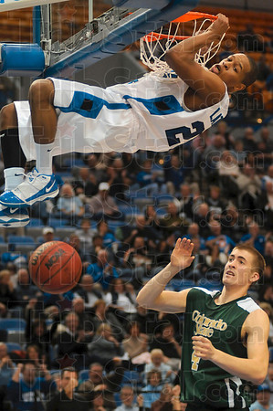 Tribune-Star/Joseph C. Garza<br /> It was a slam dunk: Indiana State's Dwayne Lathan dunks the ball as Colorado State's Pierce Hornung looks on during the Sycamores' 65-60 win Friday at Hulman Center.