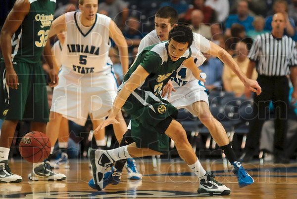 Tribune-Star/Joseph C. Garza<br /> Change of possession: Indiana State's Jake Kelly and Colorado State's Dorian Green watch as the ball bounces away after Kelly was able to strip it away from Green Friday at Hulman Center.
