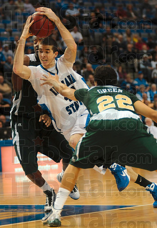 Tribune-Star/Joseph C. Garza<br /> Indiana State's Jake Kelly drives between two Colorado State defenders, including Dorian Green, during the Sycamores' 65-60 win Friday at Hulman Center.