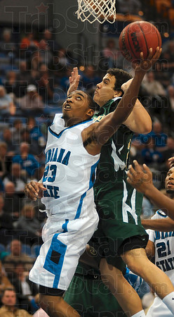 Tribune-Star/Joseph C. Garza<br /> Hard to handle: Indiana State's Harry Marshall drives under the basket against Colorado State's Dorian Green during the Sycamores' 65-60 win Friday at Hulman Center.