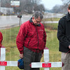 Jerry and Bob Lybarger listen as Pastor Tony Alstott of Brazil First United Methodist Church offers a prayer during the ceremony for their parents, Herschel and Marjory Lybarger, Friday on US 40 on the west side of Brazil.