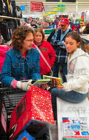 Tribune-Star/Joseph C. Garza<br /> Time to compare: Melissa Pinegar and Kayla Church compare video games as they wait in the Lay-a-way line early Friday morning at Kmart.