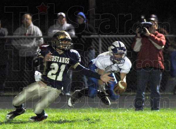 Picture this: Fountain Central defender #21, Zach Robertson watches the ball drop just off the fingertips of Rockville's wide receiver #6, Cody Jeffries during first quarter action Friday night.