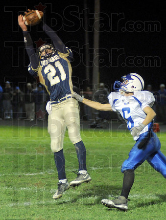Touchdown catch: Fountain Central's #21, Zach Robertson hauls in a long pass then beats his defender #6, Cody Jeffries to run the ball into the end zone for a score.