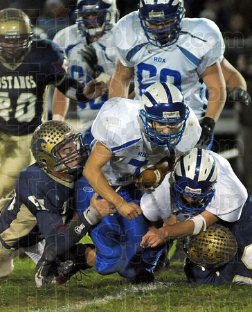 Tough yards: Rockville's #7, Tyler Bradburn churns out yardage against Fountain Central Friday night.