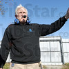 That way: Chris Fitzgerald directs the movement of a 7,000 lb. steel building Friday morning at his Terre Haute business.