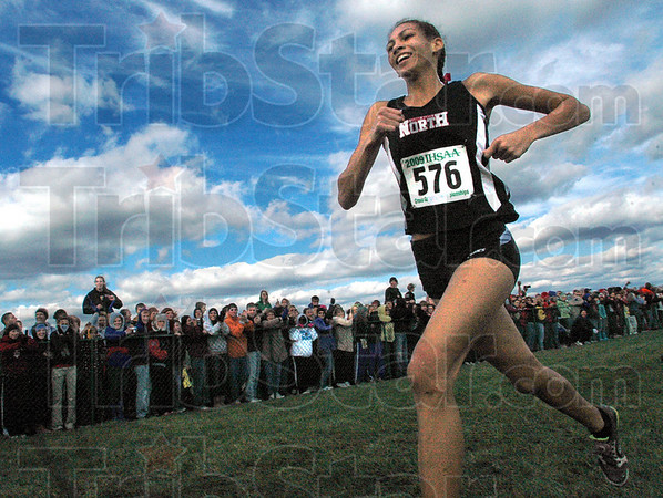 Smiley face: Terre Haute North freshman Tapring Goatee finally smiles as she strides across the finish line ahead of the field to be the 2009 State Cross Country individual winner Saturday afternoon.