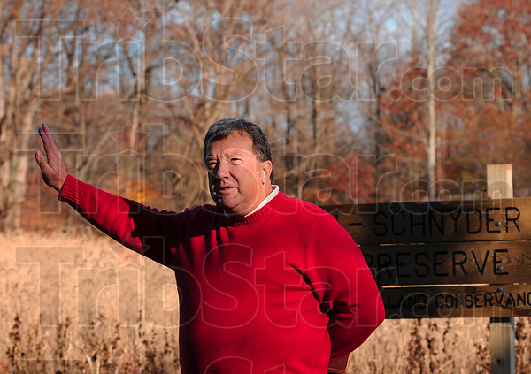 Tribune-Star/Joseph C. Garza<br /> Where he grew up: Paul Newport talks about the days he spent as a youngster playing on the land that is now the Jackson-Schnyder Nature Preserve west of St. Mary-of-the-Woods Saturday during a dedication.