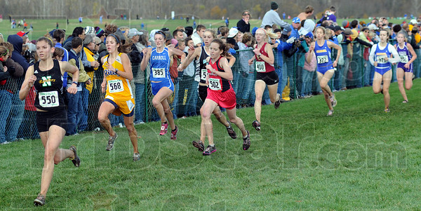 The stretch: Girl runners fight for position as they cover the last 50 yards of Saturday's race.