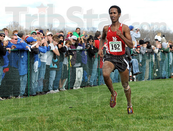 Boy's champion: Indianapolis North Central's #192, Futsum Zeinasellassie leads the field across the line to win the individual title during Saturday's Cross Country State Finals.