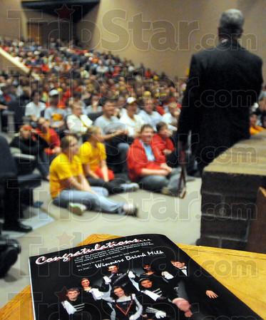 Congratulations: The headline on the magazine says it all as Northview bamd director Bob Medworth speaks with a standing-room-only crowd in the Northview auditorium Saturday afternoon after winnng another state championship.