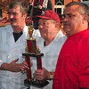 Tribune-Star/Joseph C. Garza<br /> First place: Howard Compton, center, proudly displays his first place trophy for best chili in the individual division Saturday at the end of the Altrusa Chili Cookoff. Standing with Compton are Mark Loiseau and Danny Gemmaka.
