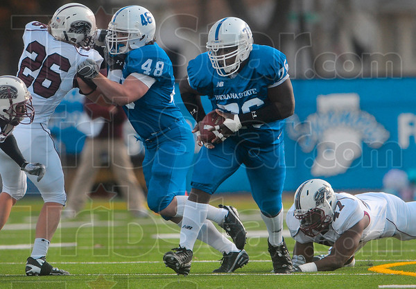 First down: Indiana State's Rod Hardy runs the ball for a first down through the Southern Illinois defense Saturday at Memorial Stadium.