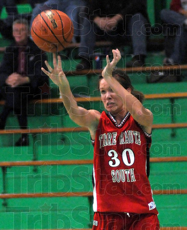Three ball: South's #30, Emily Bell launches a three-point-shot during game action against Owen Valley Saturday night during the championship game of the Clabber Girl Classic.