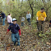 Honeysuckle habitat: A group of Cub Scounts from the Terre Haute area work to remove honeysuckle trees from Dobbs Park Saturday morning.