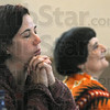 Healing tools: Two participants in the third annual workshop for The Arts as Healing Tools listen to remarks by Cathie Laska Saturday afternoon.