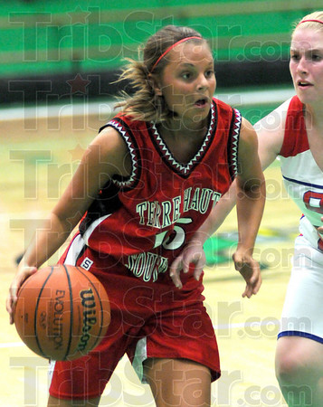 Drive: South's #15, Haley Seibert drives past her defender during game action Saturday night.