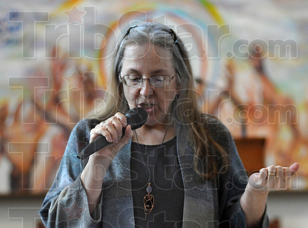 Healing tools: Zann Carter gives some opening remarks during the third annual workshop at the Unitarian Universalist Church.