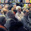 Storyteller: A large group of people listen to stories being told by Tom Roznowski from his new book during Saturday's event at the Vigo Co. Public Library.