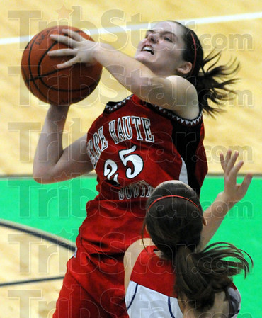 Determined: South's #25, Mikayla Metheny takes the ball to the hoop during Clabber Girl play Saturday night.