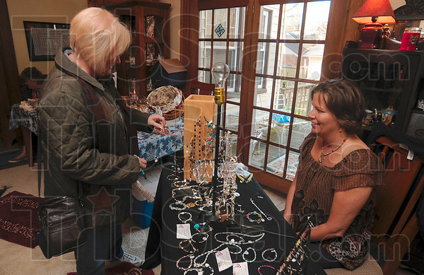 Tribune-Star/Joseph C. Garza<br /> Looking for a snowman: Sally Sandlilands looks through Sally Rubey's handcrafted jewelry for a snowman, which she found, during the Collett Park Craft Walk Saturday.