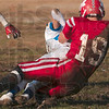 Forced the fumble: Marshall's Taylor Duncan forces a Maroa-Forsyth opponent to fumble during the Lions' game against the Trojans Saturday in Marshall.