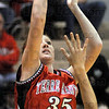 Soft: Terre Haute South's #35, Hannah Lee launches a short jumpshot against a Northview defender Saturday evening.