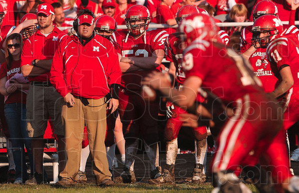 Tribune-Star/Joseph C. Garza<br /> Calling the action: Marshall head coach Todd Evers watches the Lions move the ball up the field during the team's semifinal loss to Maroa-Forsyth Saturday in Marshall.
