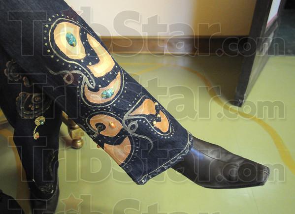 Custom artwork: Laura Tucker wears a pair of custom painted jeans by Parisa Keywanford.