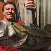 Tribune-Star/Joseph C. Garza<br /> What he was after: Don Rogers displays a mounted big mouth bass Sunday at his home like the one he was hoping to catch during a fishing trip to Florida's Myakka River State Park  in 2008.