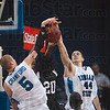 Tribune-Star/Joseph C. Garza<br /> Denial duo: Indiana State's Josh Crawford and Jake Kelly simultaneously block University of Indianapolis' Darius Adams during the Sycamores' 82-67 win Saturday at Hulman Center.
