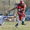 Escape: Marshall's #46, Andre Strohm fends off a tackler to gain some yardage during game action Saturday.