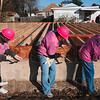 Tribune-Star/Joseph C. Garza<br /> Thrice the hammering: Women Build members Zulma Estremera, Susan Hurtt and Marie Hollis drive nails into the frame of a home at 931 Gilbert Avenue Saturday.