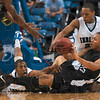Tribune-Star/Joseph C. Garza<br /> Four on the floor: Indiana State's Isiah Martin and Dwayne Lathan try to steal the ball from University of Indianapolis' Larry Woods, right,  as he tries to pass it to teammate Darius Adams Saturday at Hulman Center.