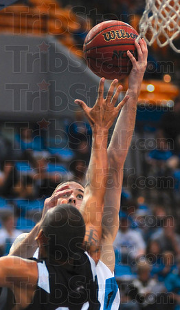 Eye on the prize: Indiana State's Jake Kelly eyes the basket as he shoots over a University of Indianapolis opponent during the Sycamores' win Saturday at Hulman Center.