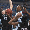 Tribune-Star/Joseph C. Garza<br /> Harry's back: Indiana State's Harry Marshall doesnÕt hesitate to drive to the basket after snatching a rebound against University of Indianapolis' Sergey Struck and Darius Adams.