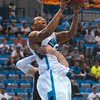 Tribune-Star/Joseph C. Garza<br /> A dunk denied: Indiana State's Dwayne Lathan is denied a dunk by the University of Indianapolis's Nate Blank during the Sycamores' win Saturday at Hulman Center.
