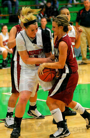 Tribune-Star/Joseph C. Garza<br /> Within their grasp: Terre Haute North's Mary Kate Etling and Northview's Carlee Bell tangle for possession of the ball during the Patriots and Knights' game Wednesday at West Vigo in the HI-99 Terre Haute Savings Bank Classic.