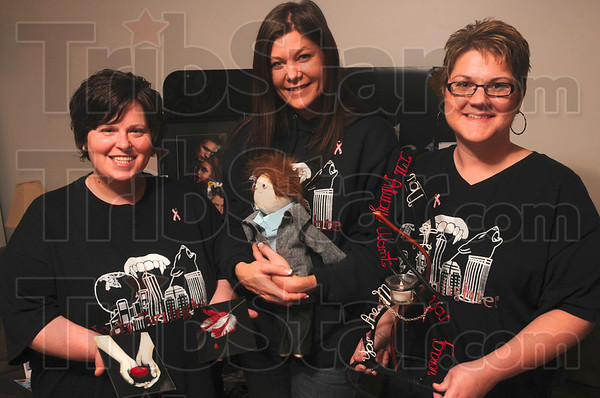 Tribune-Star/Joseph C. Garza<br /> Twihard trio: Twilight fans, Amy Martin of Clinton, Andrea Dunn of north Terre Haute and Mary Ruiz of Brazil, show off some of their handmade Twilight items Wednesday at Dunn's home.