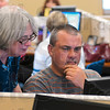 Tribune-Star/Joseph C. Garza<br /> Job search assistance: Cathy McGuire, an AARP administrative assistant, helps Danny Gemmaka with his job search Wednesday in the new WorkOne Western Indiana Service Center.