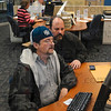 Tribune-Star/Joseph C. Garza<br /> Put to good use: Rob Engles uses a computer in the job search area in the WorkOne Western Indiana Service Center with some help from Dave Amerman of Employment Solutions Wednesday.