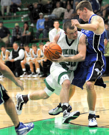 Driven: West Vigo's #30, Cody Thornton drops his shoulder and drives to the basket against a North Vermillion defender Wednesday night.